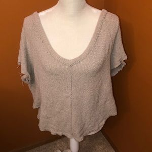 Free People sweater unfinished hems at arms